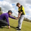 PGA Pro, Lee Jordan, teaches this boy the correct way to hold a club